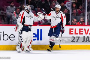 MONTREAL, QC - JANUARY 09: Washington Capitals Left Wing Alex Ovechkin (8) meeting Washington Capitals Goalie Braden Holtby (70) to celebrate his goal, the fourth of the game making the score 4-1 Capitals during the Washington Capitals versus the Montreal Canadiens game on January 9, 2017, at Bell Centre in Montreal, QC (Photo by David Kirouac/Icon Sportswire)